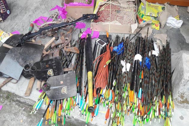 DARJEELING, JUNE 15 (UNI):- West Bengal police recovered huge cache of arms and ammunitions including bows and arrows at Gorkha Janamukti Morcha (GJM) chief Bimal Gurung's residence, in Darjeeling on Thursday. UNI PHOTO-14U